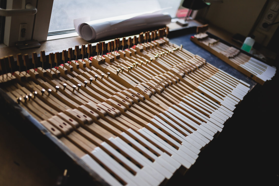 Piano keys taken out of the piano for inspection