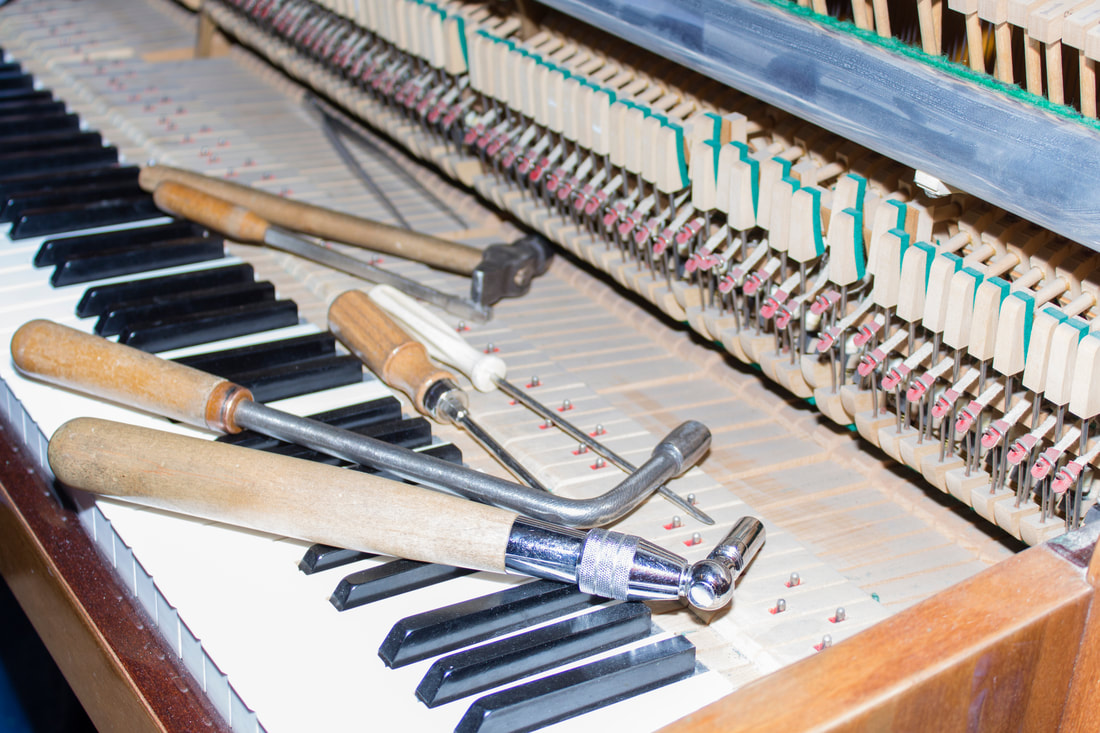 Piano Tools laying on open piano