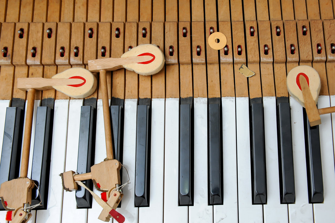 Piano key with two piano hammers on the left